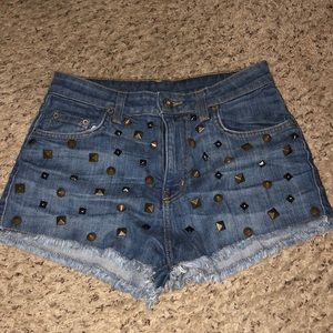 Medium wash high waisted studded shorts